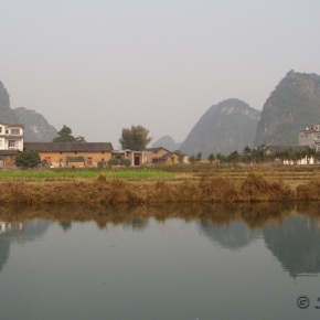 Cruising on a bamboo boat in Yulong River, Guilin