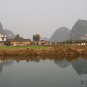 Cruising on a bamboo boat in Yulong River,Guilin